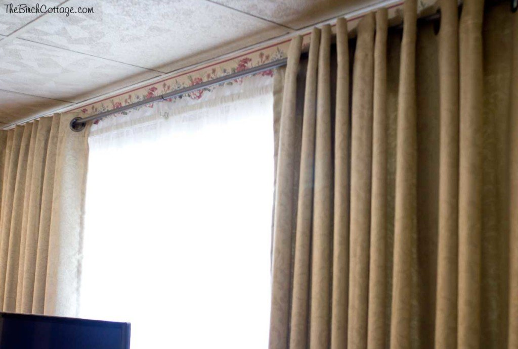 A really cheap way to make a DIY Curtain Rod.