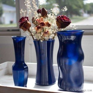 A super easy DIY project for spray painting ordinary glass vases by The Birch Cottage.