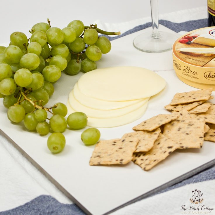 The Birch Cottage shares how to make a cheese cutting board from ceramic tile!