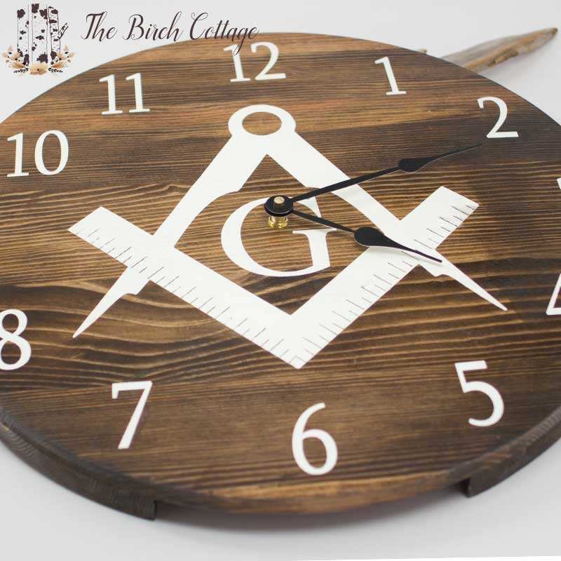 This Freemason Wooden Clock is handmade from reclaimed fence pickets and is available for purchase on The Birch Cottage Shop on Etsy.
