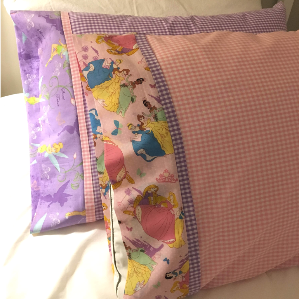 Learn how to sew a pillow case with contrast cuff and trim using the burrito method. Handmade pillow cases are easy to make and can be so easily customized!