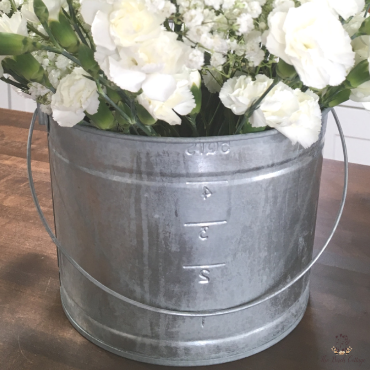Learn how to age galvanized metal by The Birch Cottage