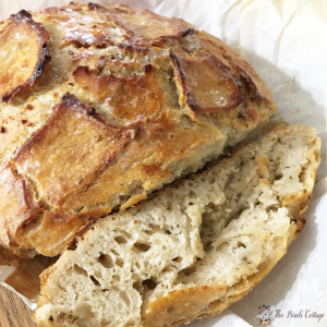 Garlic Parmesan Sourdough Bread on parchment paper