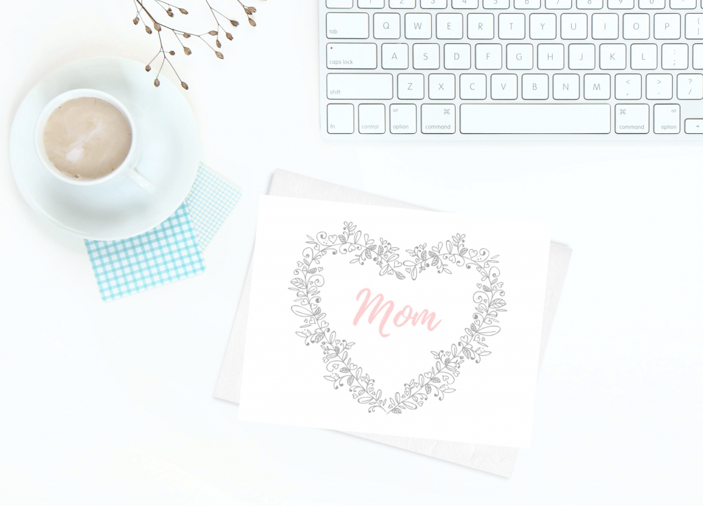 card with Mom, cup of coffee and computer keyboard