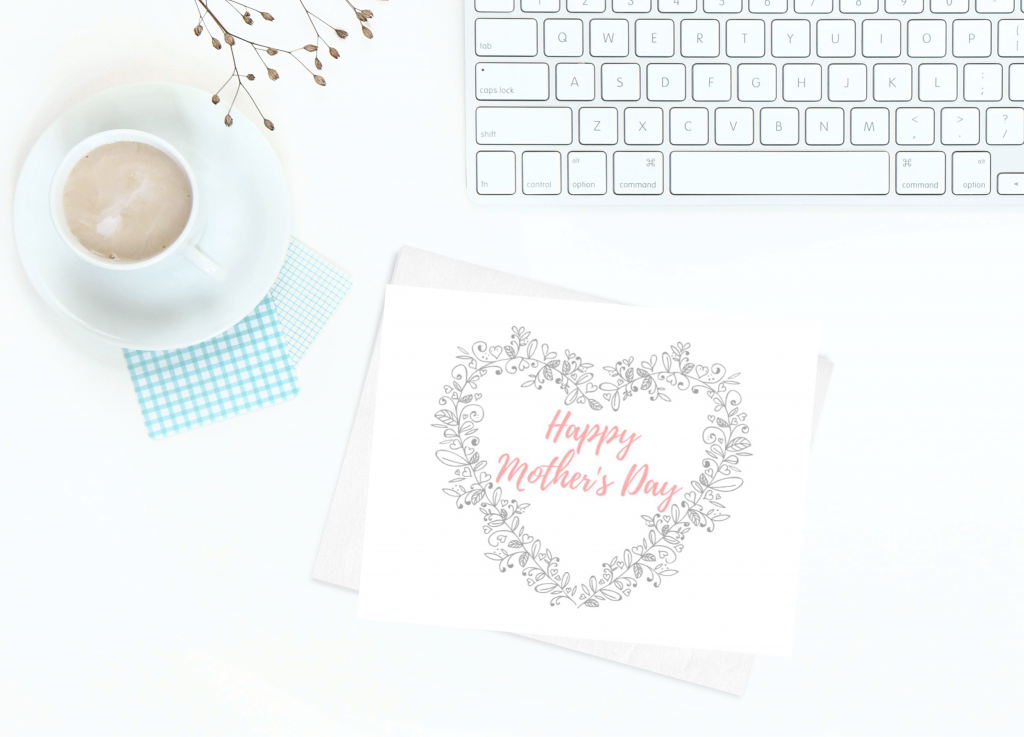 card with Happy Mother's Day, cup of coffee and computer keyboard