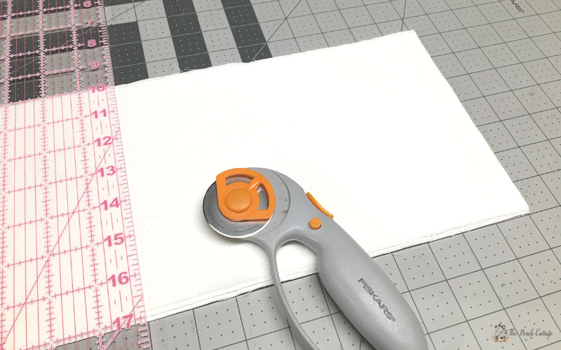 fabric, ruler, rotary cutter, cutting mat