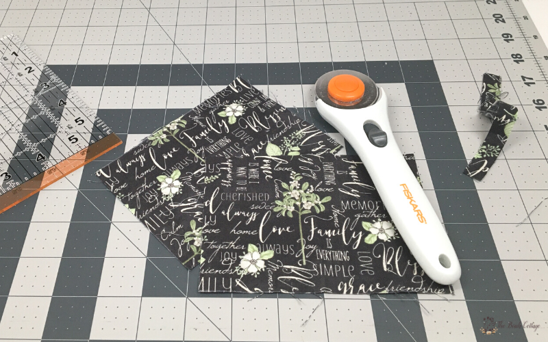 ruler, fabric, rotary cutter and mat