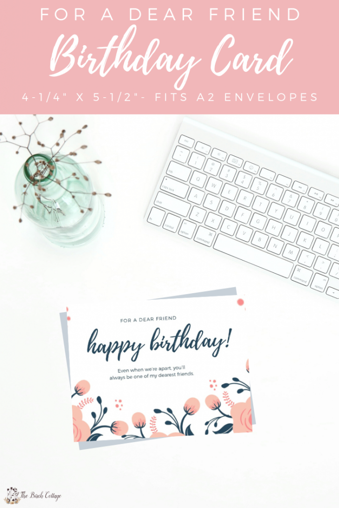 computer keyboard, vase of flowers, and birthday card