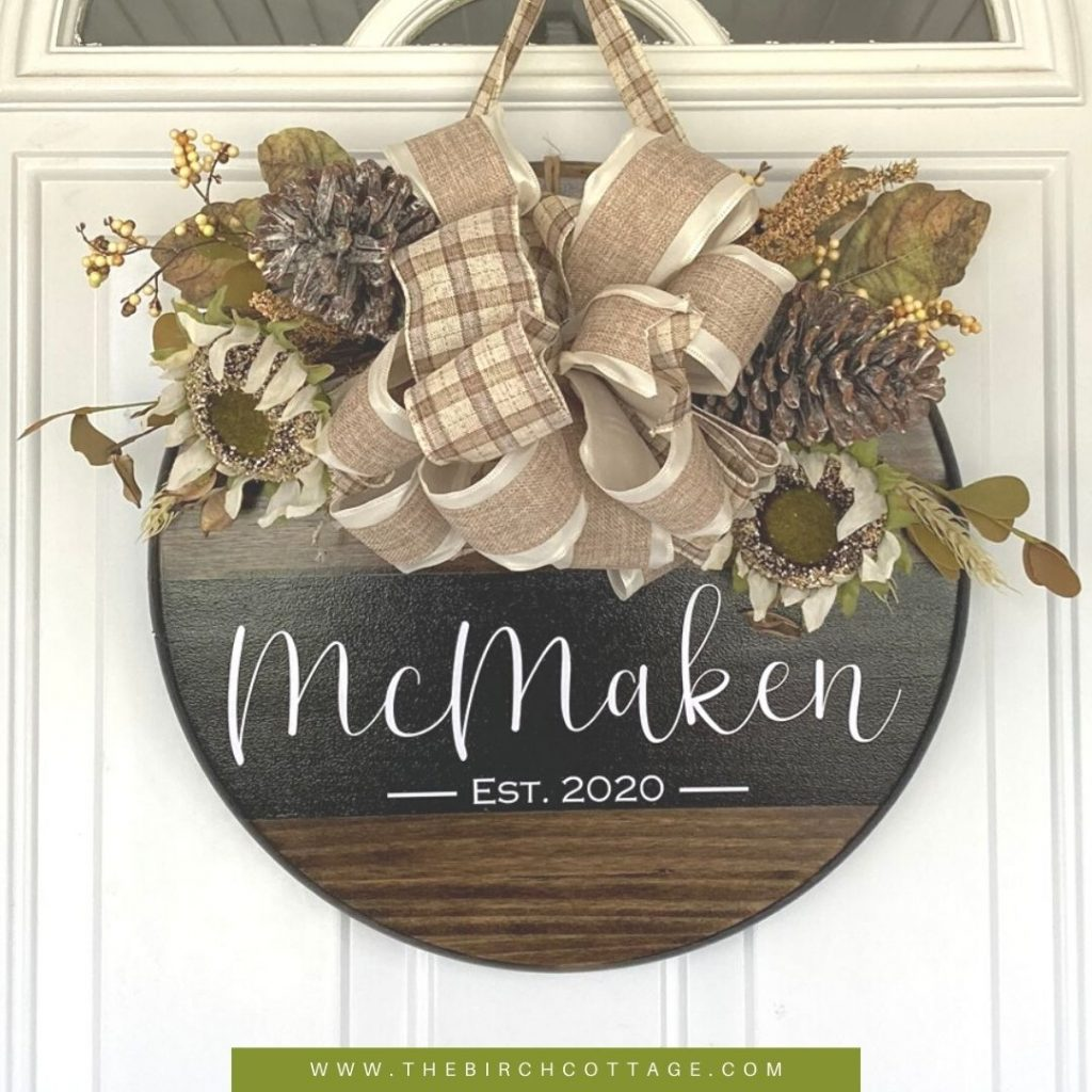 Learn how to make a custom round wooden door hanger using your Cricut cutting machine, a round piece of wood, paint and artificial flowers.